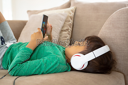 boy with headset playing game on