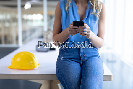 female architect using mobile phone in