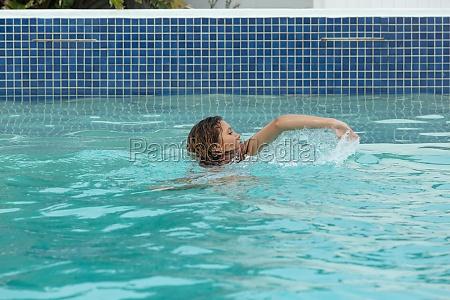 woman swimming in swimming pool in
