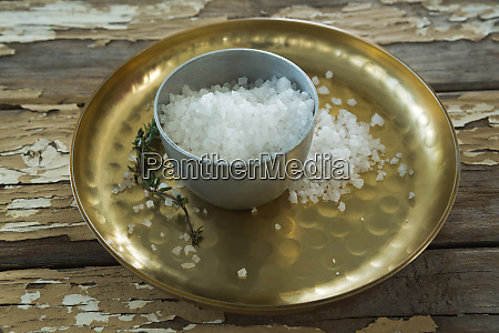 bowl of salt in a plate