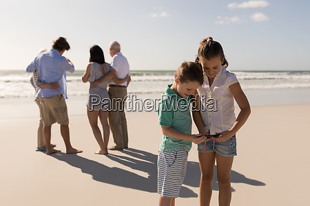 siblings using mobile phone