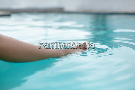 womans feet in swimming pool