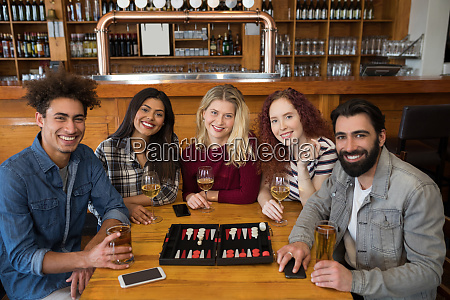 friends having glass of beer in