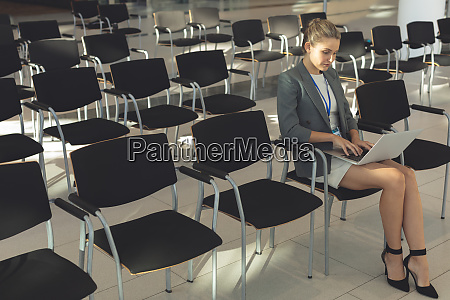 businesswoman working on laptop in conference