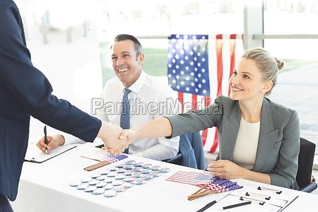 businessman shaking businesswoman hands during interview