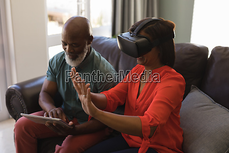 senior couple using digital tablet and