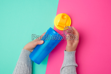 plastic blue shaker bottle with a