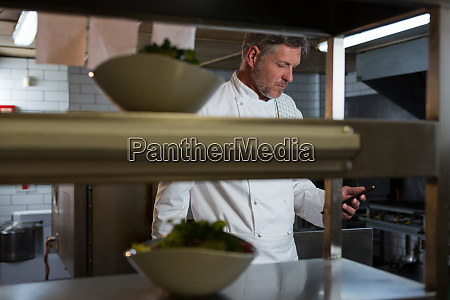 male chef using mobile phone