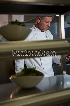 male chef using mobilephone