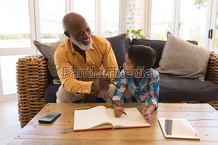 grandfather helping his grandson with homework