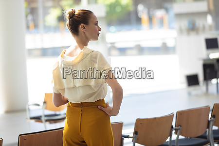 caucasian female executive looking away while