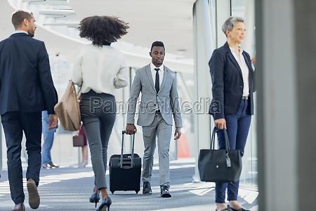 diverse business people walking in corridor