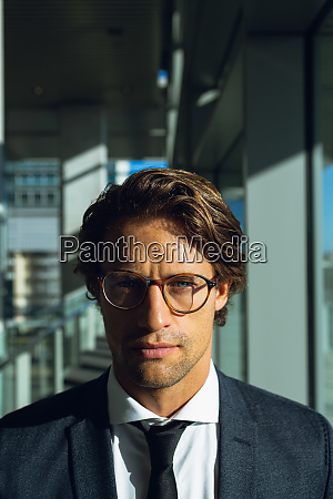 businessman looking at camera in a