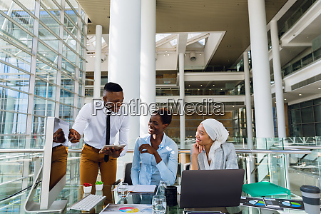 male and females executives discussing over