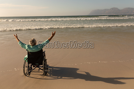 disabled senior man with arms outstretched