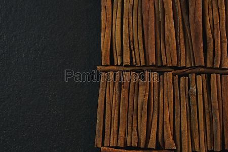 cinnamon sticks arranged in a row
