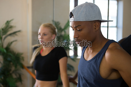 thoughtful male dancer with friend