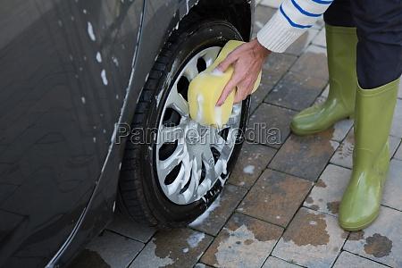 auto service staff washing a car