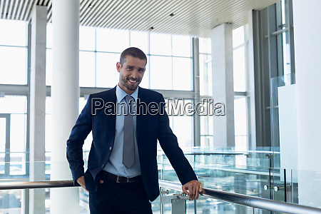 businessman smiling to camera in modern