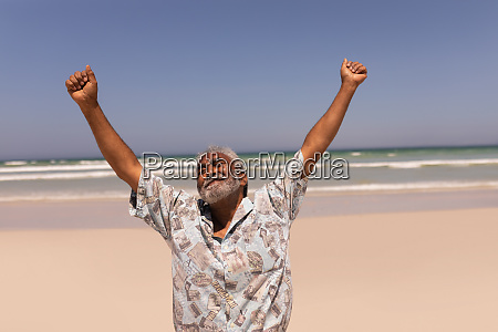 senior black man with arms outstretched
