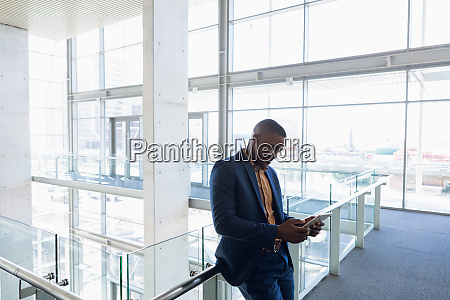 businessman using tablet computer at work
