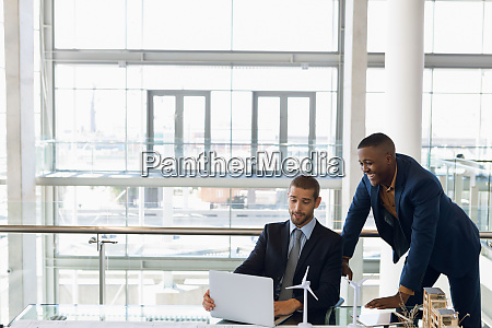 two businessmen working together in a