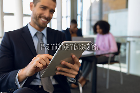 businessman using tablet in a modern
