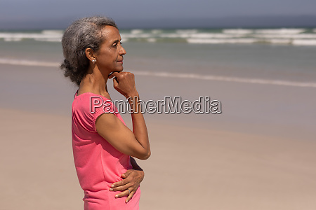 thoughtful senior woman with hand on