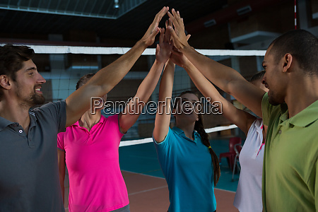 volleyball players giving high five at