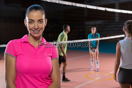 portrait of smiling volleyball player by