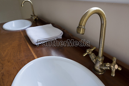 sinks with steel taps installed on