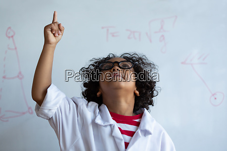 schoolboy pointing finger up in laboratory
