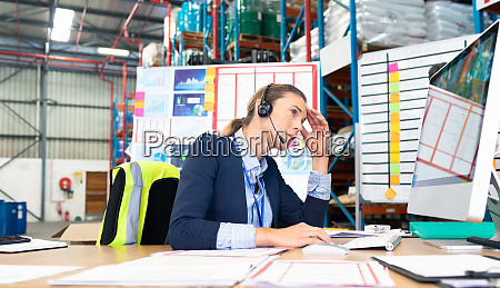 female manager working on computer at