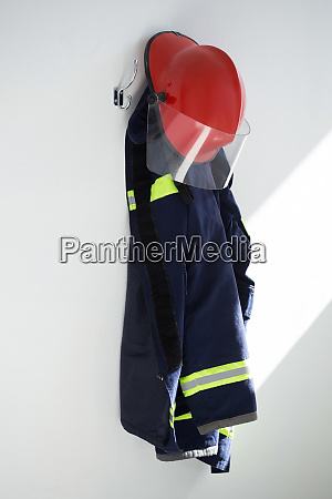 protective workwear hanging on hook