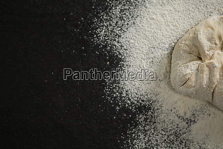 cropped image of flour on dough