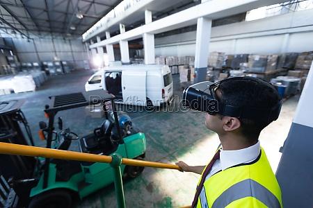 male supervisor using virtual reality headset