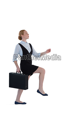 female executive pretending to climb the