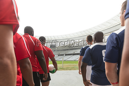 rugby teams standing in a row