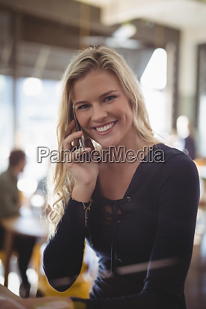 portrait of smiling young blond woman