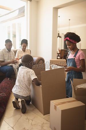 african american children unpacking their belongings