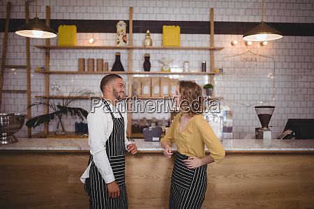 smiling young wait staff standing at