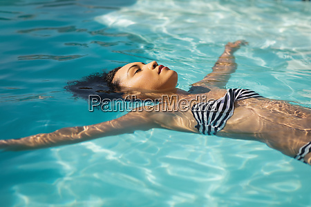 young mixed race woman floating in