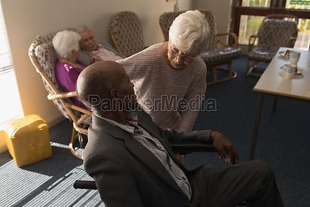 senior woman talking with disable senior