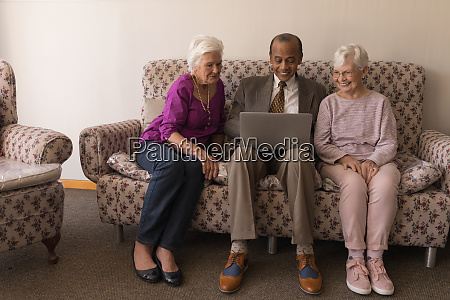 front view of senior friends using