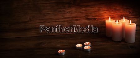 candles on dark wood