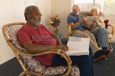 blind senior man reading a braille