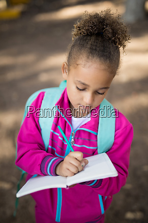 close up of girl writing in