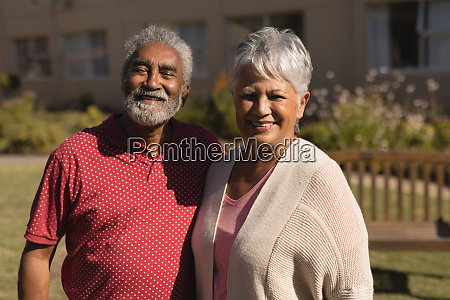 senior couple standing in the park