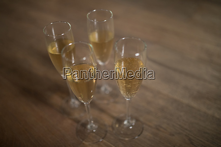 glasses of champagne arranged on table