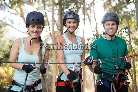 friends getting ready to zip line